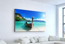 Foto op canvas met bootje op zee aan woonkamermuur